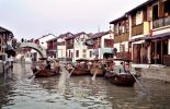 Travelling through the canals of a watertown